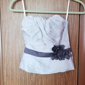 Pleated halter top with floral accent